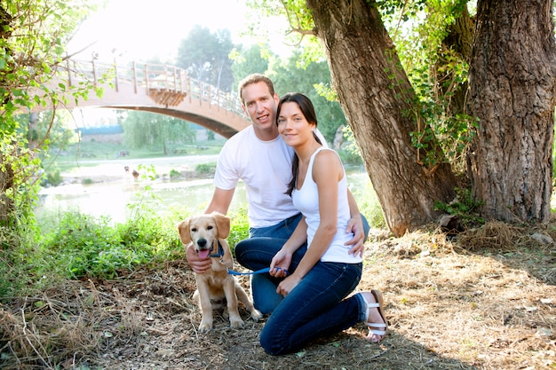 Couple in love with dog in outdoor river