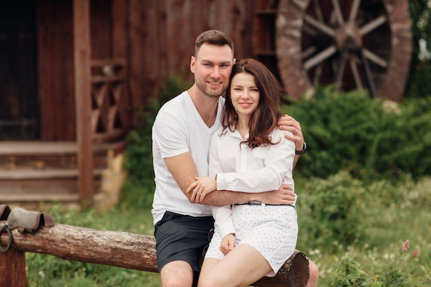 Couple in love at wooden mill