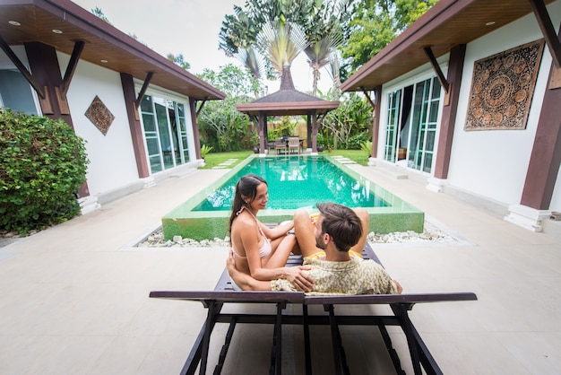 Couple of lovers in a beautiful villa with swimming pool