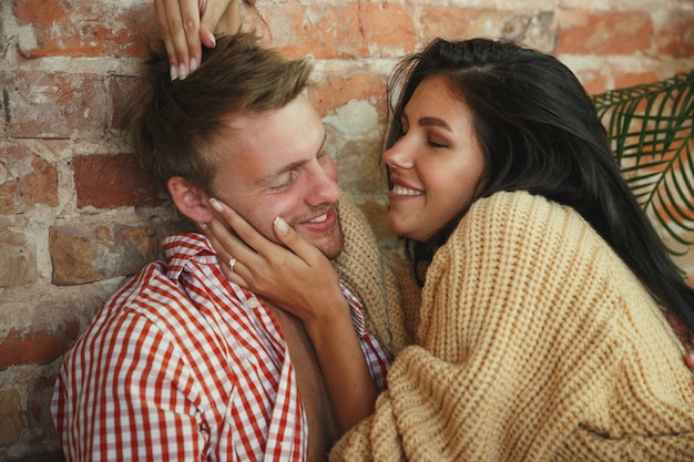 Couple of lovers at home relaxing together, comfortable