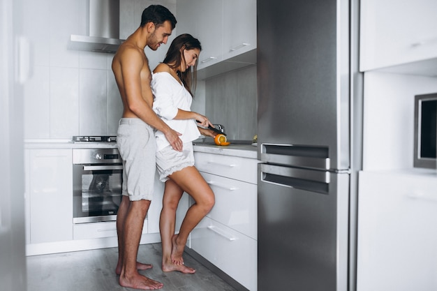 Couple making breakfast together at the kitchen