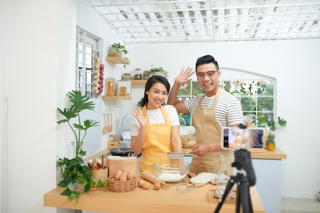 Couple making dough together, baking and cooking concept rustic style photo for cook book and cook blog