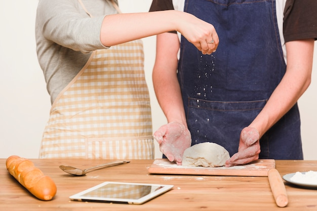 Couple making dough together