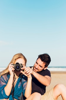 Couple making pictures on beach