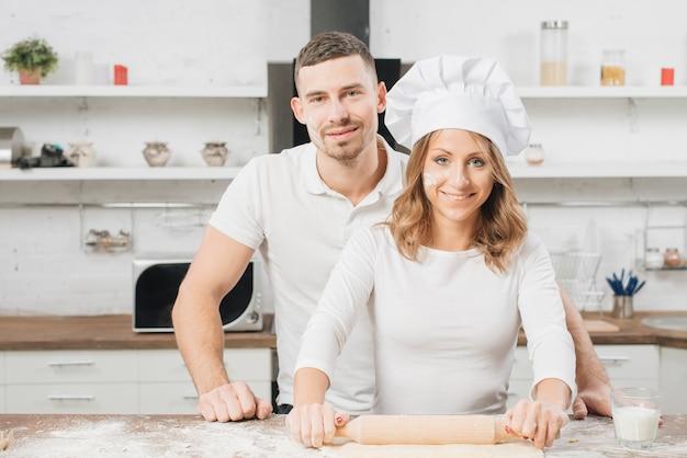 Couple making pizza dough