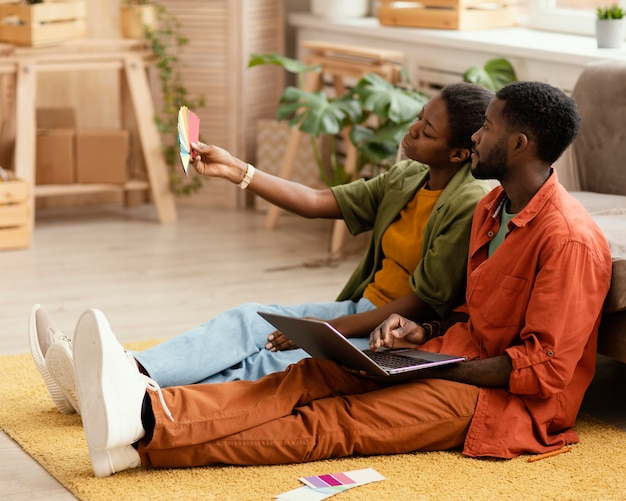 Couple making plans for renovating home using color palette
