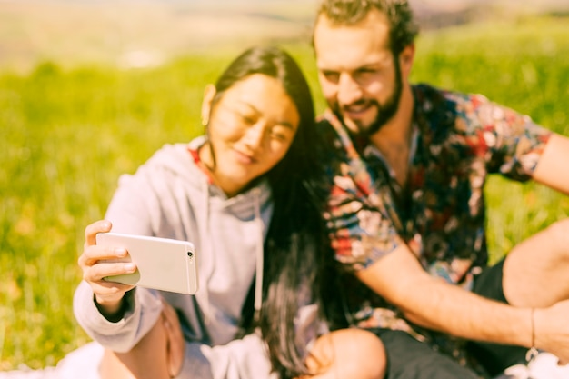 Couple making selfie on smartphone