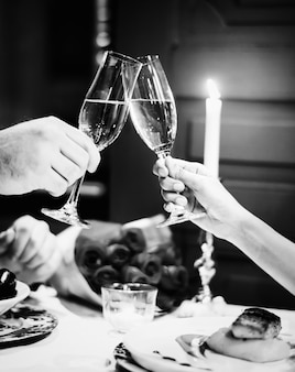 Couple making a toast at a romantic dinner