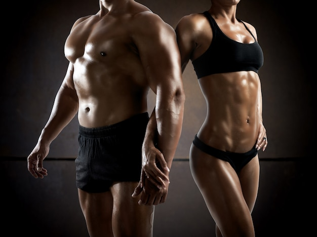 Couple man and woman muscled and bodybuilder