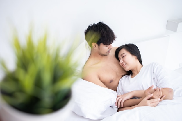 Couple man and woman slpeeing on bed