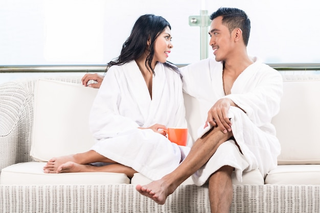 Couple in morning sitting on couch