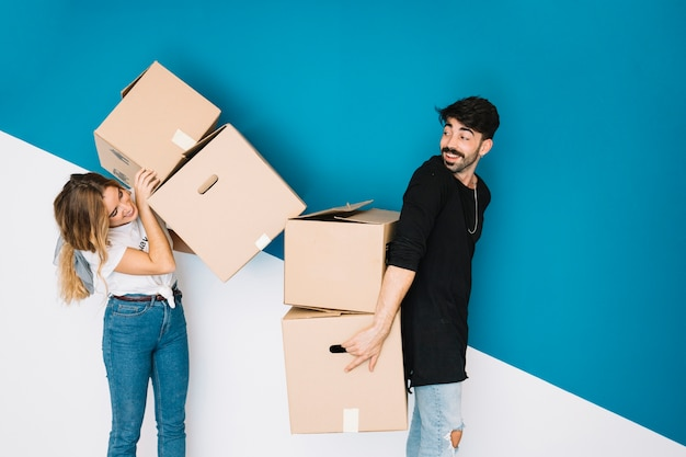 Couple moving to new flat with boxes