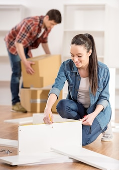 Couple moving in new home house.