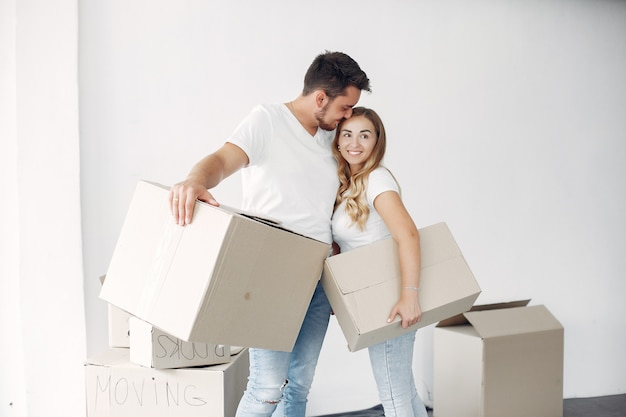 Couple moving and using boxes