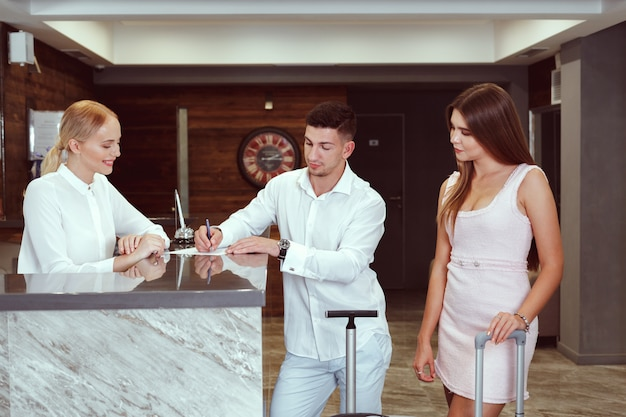 Couple near reception desk in hotel