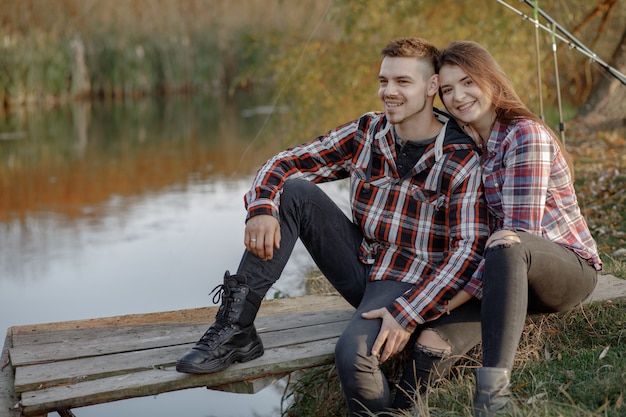 Couple near river in a fishing morning