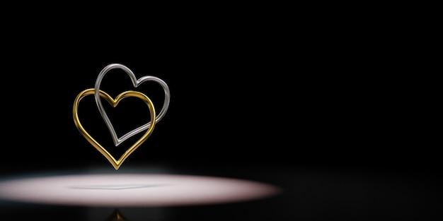Пара прикованных золотых и серебряных колец в форме сердца на черном фоне