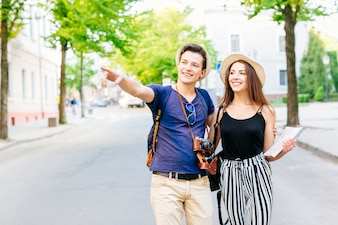 Couple on vacation in city walking on road