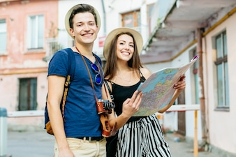 Couple on vacation in city with map