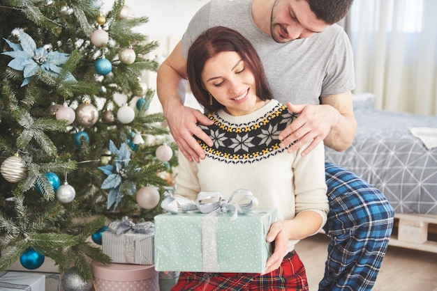 Couple opening presents on christmas