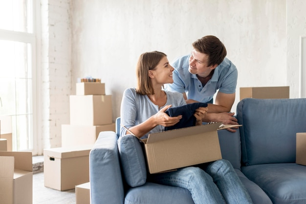 Couple packing box to move house