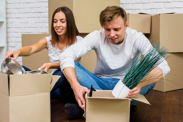 Couple packing their things in boxes