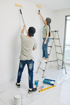 Couple painting walls