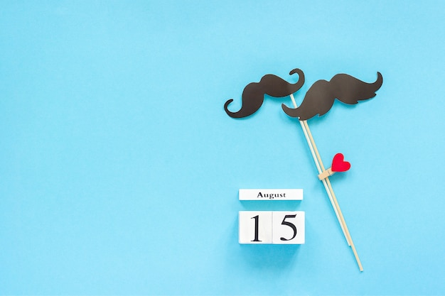 Couple paper mustache props, calendar 15 august. concept homosexuality gay love. international gay day