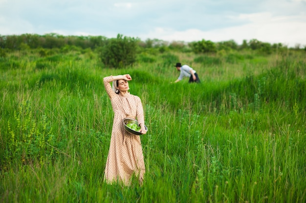 Couple picking fruits in the meadow