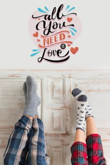 Couple in pijama and qoute for valentines day Free Photo