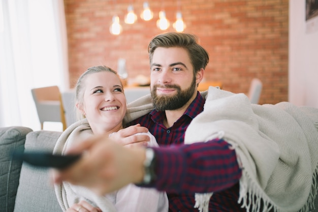 Couple in plaid with remote controller