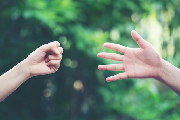 Couple play rock paper scissors hand game