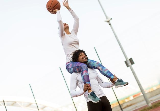 Couple playing basketball