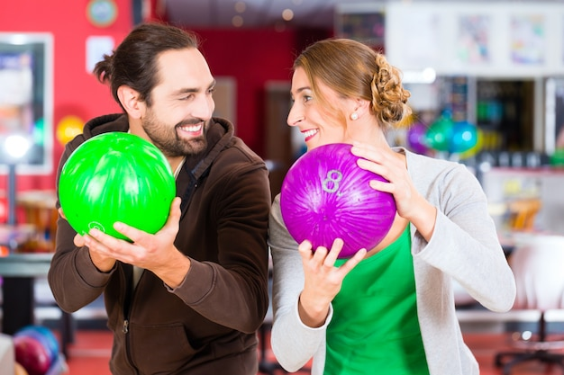Couple playing bowling