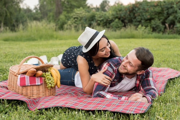 Couple playing on a picnic blanket