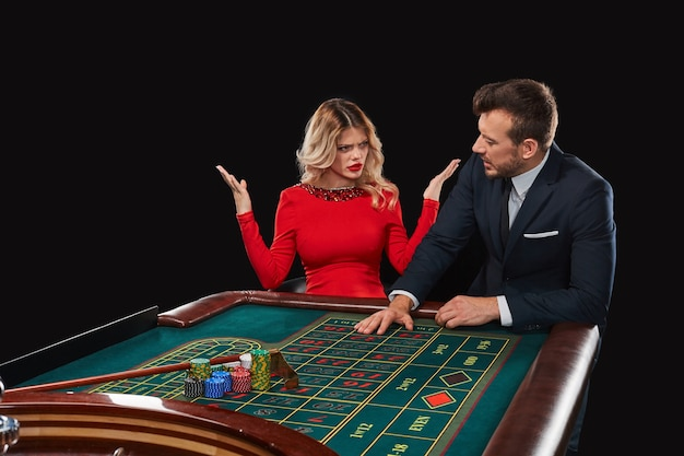 Couple playing roulette wins at the casino. addiction to the gambling. girl unhappy man because of the fact that he lost