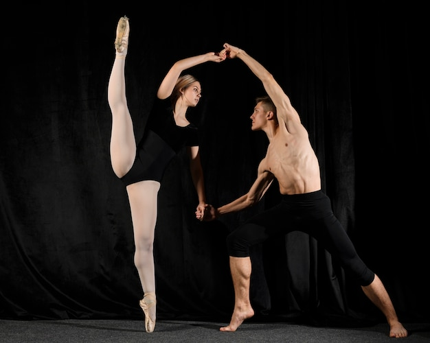 Couple posing in ballet outfits