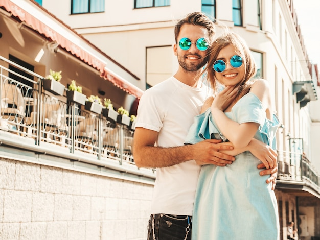 Couple posing on the street in sunglasses