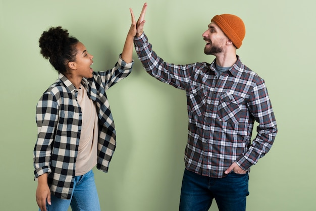 Couple posing while high-fiving