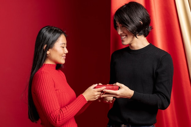 Couple posing with gift for chinese new year