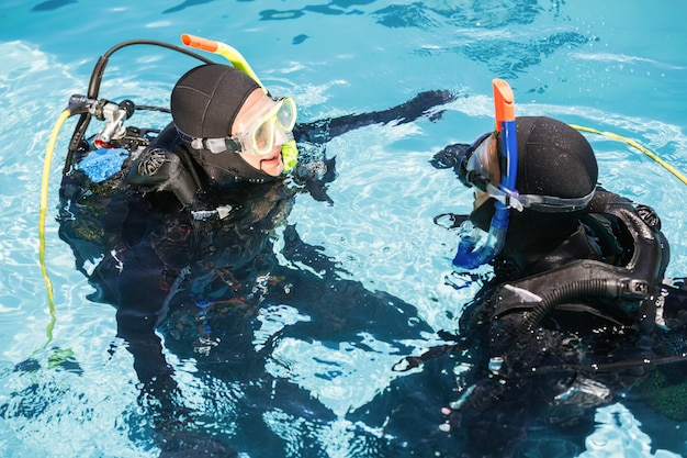 Couple practicing scuba diving together