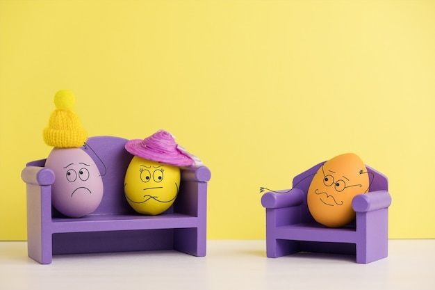 Couple at a psychologist. easter holiday concept with cute eggs with funny faces. different emotions and feelings. mental health in the family