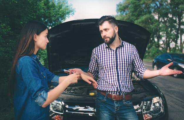 The couple quarreled, the car broke down on the road Premium Photo