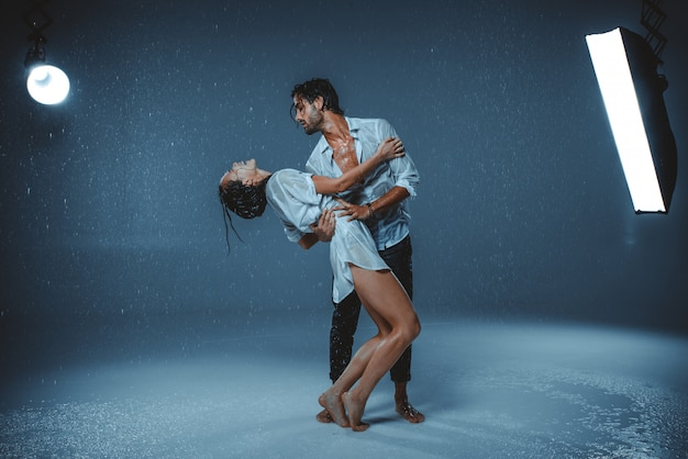 Couple under the rain indoors