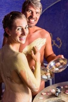 Couple at rasul bath in wellness spa