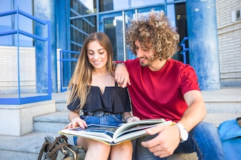 Couple reading textbook together