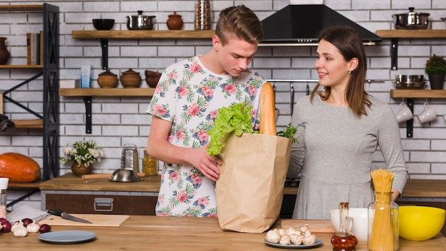 Couple ready to cook together in kitchen