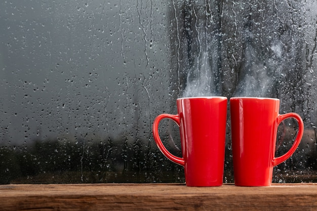 Couple red cup with the rain