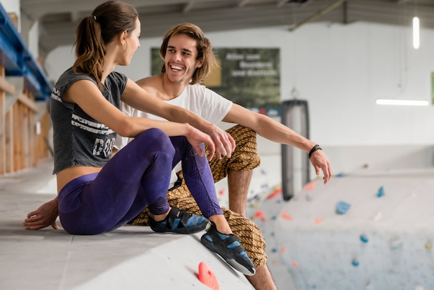 Couple relaxing after bouldering