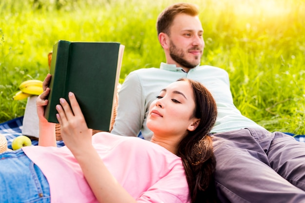 Couple relaxing on picnic in park